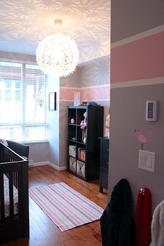 pink and gray nursery full of chic goodness --- love the light fixture/pattern it gives to the ceiling.