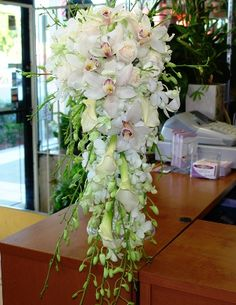 Bridal Cascading bouquet orchids, callas and roses. Once again done with red roses. Maybe some yellow orchids.