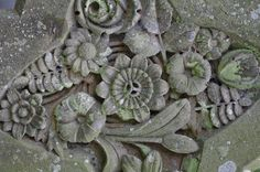 Weathered floral imagery on Victorian gravestone at Christ Church Welshpool
