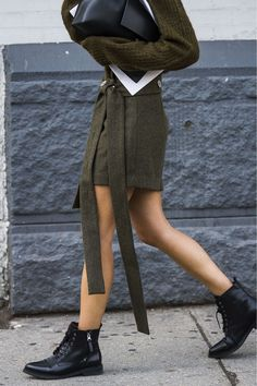 INSPIRATION | Military skirt & jumper in army green with black lace-up boots at NYFW | @styleminimalism