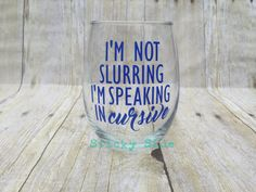 Im not slurring, Im speaking in cursive, stemless wine glass. I currently only have 15oz stemless wine glasses. I will list here when I have a larger option. This is a fun wine glass with a sense of humor. This glass would be a fun gift, or buy it for yourself. The wording can be made in other colors as well. If you dont indicate what color you want at the time of order, it will be made as pictured (light teal wording). *** Designs are NOT hand painted*** PLEASE NOTE: Each item is hand…
