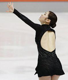 Yuna Kim performing her free skate at the Sochi Olympics, Black Figure Skating / Ice Skating dress inspiration for Sk8 Gr8 Designs.