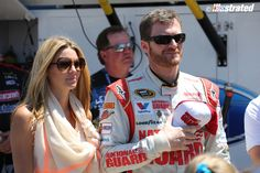 Amy Reimann and Dale Earnhardt Jr. at Michigan International Speedway, June 2014. (Photo by Elmer Kappell.)