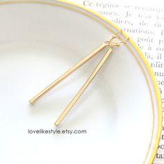 dangly gold bar earrings - Etsy  https://www.etsy.com/listing/214093744/long-skinny-gold-bar-earrings-simple
