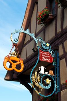 """Sign Bakery sign in Alsace, France. Photographer wrote: """"Since Alsace belonged to Germany for 800 years, pretzels are very popular here.""""German German(s) may refer to: Alsace, Muebles Estilo Art Nouveau, Blade Sign, Haute Marne, Bakery Sign, Storefront Signs, Pub Signs, Store Signs, Hanging Signs"""