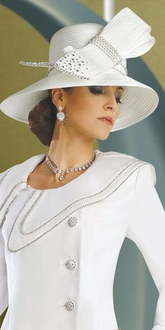 NO I don't want this hat... but the band of rhinestones and the double loop gives me an idea for how to deal with the sash on my dress...