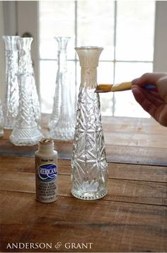 Begin making your distressed candlesticks by painting the glass vases with Americana's Khaki Tank Paint