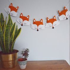 Five hanging foxes - perfect finishing touch for a woodland nursery. Handmade felt fox bunting / garland made in Tring.