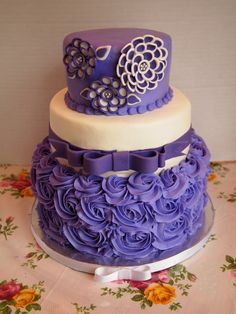Purple wedding. The tiers are Italian cream, red velvet, and WASC.