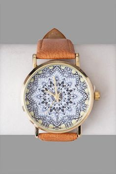 "Find your zen with the Sri Lanka Printed Watch. This faux leather watch features an abstract lotus flower on the dial.  <br><br>    -	.75"" band width<br>  -	1.5"" diameter (face) <br>  -	Battery operated<br>  -	Twist crown to set<br>  -	Imported<br>"