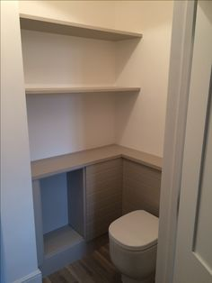 Shelves and boxing in cloakroom