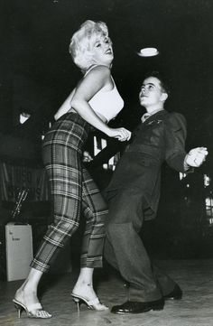 casualswiss:  Jayne Mansfield dancing with a soldier at a USO show.