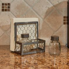 """Vintage Farmhouse Style has never been more fabulous! This Chicken Wire Salt/Pepper & Napkin Caddy evokes a farmyard feel, perfect for today's country style kitchen.Thisholderis also ideal for a picnic table. It holds napkins, and mini-Mason jar saltandpeppershakers with vintage style lids. Made of aged wire, metal, and glass.6""""H x 6""""W x 4.5""""D"""