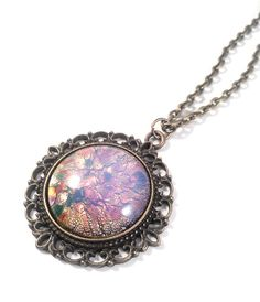 Vintage Czech Harlequin Opal Rainbow Glass in Antiqued Brass Bronze Lace Pendant on Necklace by JujusStuffs