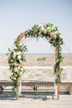 gorgeous floral ceremony arch via Britt Croft