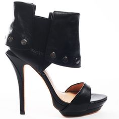 Embrace your fashionable side with these luxe heels from L.A.M.B. Quinlan reveals soft black leather throughout with a single strap at the vamp. An elasticized cuff with silver stud detail sits at the ankle. A 4 inch stiletto heel is complete with a 1 inch double platform.