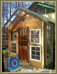 the greenest garden/potting shed in all of Virginia and Maryland! They reused and recycled and repurposed ... the old siding, doors, trim, windows, beams, stained glass and even a wagon wheel that used to be a lamp! It still needs some decoration and plants of course but it's already looking pretty spectacular!