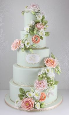 Mint and Peach Cake by The Fairy Cakery.  Beautiful shade of mint with peach cascading roses and silver ribbon at the edges.  Gorgeous cake.  ᘡղbᘡ