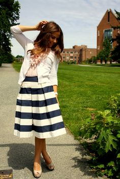 This girl understands pleats, stripes, and skirts.  She perfectly combines all three.