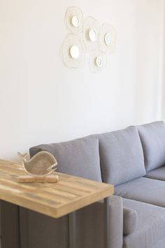 gallery wall decoration for beach house, minimal interior decoration, living room side table ideas, grey sofa ideas, grey couch, earth tone, natural hues Grey Couches, Gray Sofa, Sofa Ideas, Earth Tones, Beach House, Living Room Decor, Minimalism, Interior Decorating, Gallery Wall