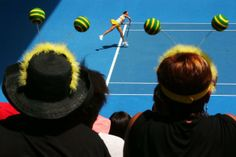 MELBOURNE, AUSTRALIA - JANUARY 19: Fans watch as Flavia Pennetta of Italy serves in her fourth round match against Angelique Kerber of Germany during day seven of the 2014 Australian Open at Melbourne Park on January 19, 2014 in Melbourne, Australia. (Photo by Scott Barbour/Getty Images)