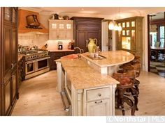 Rustic kitchen island with sink and bar