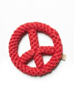 Peace Sign Rope Dog Toy   Made for the grooviest of pups, this AZO-free dog toy is shaped like a peace sign and is sturdy enough to keep up with the rowdiest breeds.    *By Jax and Bones