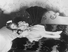 "Memento Mori (""Remember your Mortality"" in Latin) Death Photo. Victorian Era. Little girl and her doll."