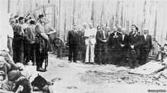 Leaders of the Jewish community of the town of Balti (right) are seen before their execution on July 15, 1941. German soldiers stand at left. (Photo: Matatias Carp, Cartea Neagra - Bucharest, 1947 - Volume III)