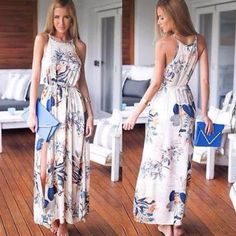 Bohemian maxi long dress A gorgeous maxi dress! Beautiful print, high neck, sleeveless comes with waist drawstring belt. So flattering.wear it up or down. A must have. ALL OF MY ITEMS ARE BRAND NEW IN A SEALED UNOPENED BAG. I SHIP DAILY I OFFER 20% DISCOUNTS ON BUNDLES!!! Dresses Maxi