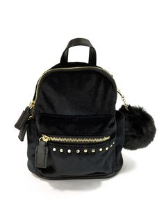 Faux fur backpack with adjustable straps, handle, inside compartments,  pockets, zipped outer pocket. Jossie Ochoa 08a7fe7dfd