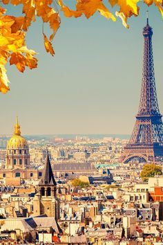Paris in the fall with a half leaf border and the Eiffel Tower rising above the city landscape