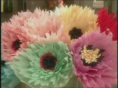 Martha Stewart and Helen Quinn cut crepe paper to create centerpiece blooms that resemble giant poppies for a birthday party centerpiece.
