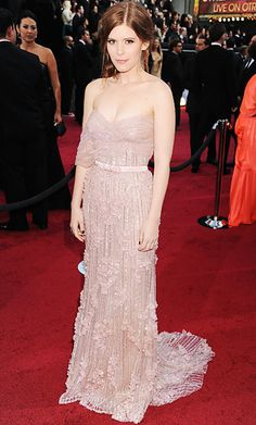 #Oscars Kate Mara  American Horror Story actress Kate Mara walked the red carpet in a strapless embellished Jack Guisso Couture gown with Lorraine Schwartz jewels, Brian Atwood shoes and a loose chignon.