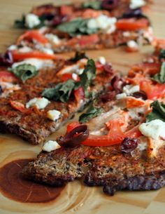 ---Eggplant pizza crust--- 1 whole eggplant 1 omega 3 egg 1/4 cup flax seed meal 1/4 cup almond meal/flour Salt and pepper to taste Extra Virgin Olive Oil (to lightly grease the parchment paper)