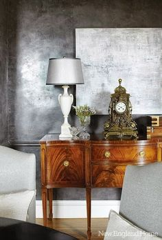 vintage sideboard, antique lamp, alabaster lamp mixed with modern wall treatments