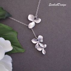 Bridal Jewelry - Orchid Jewelry - Orchid Lariat Necklace - Sterling Silver - Flower Necklace - Dainty - Bridesmaid Necklace - Bride. $28.50, via Etsy.
