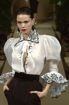 Haute Kills — Yves Saint Laurent haute couture s/s white blouse with black accents.YSL Nothing chicer than a gorgeouse blouse!now this is a Prince Poppy cock shirt. just too much for any real human