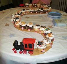 Cupcake Train we used for a Baby Shower - also good for a boy's Birthday party!  Just add peppermint rounds to the bottom of the cupcakes (we used hot glue) and crushed up candy on the tops of the cupcakes to look like 'coal'