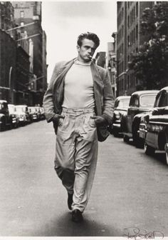 James Dean walking down the street photographed by Roy Schatt
