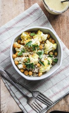 roasted cauliflower and chickpeas with lemon-dijon dressing. Tasty and healthy!