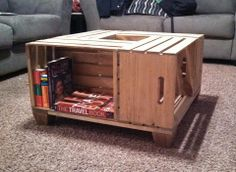 A coffee table made out of wooden crates. We cut a piece of glass to fit over the top to create a level surface. Perfect for game nights!