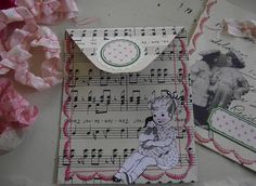 little paper pockets by littlepinkstudio, via Flickr