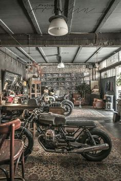 Motorbikes on the living room or like living room on the garage? I found this amazing OFFICINE RIUNITE MILANESI garage by accident way and just walked. Industrial Storage, Industrial House, Vintage Industrial, Industrial Style, Motorcycle Workshop, Motorcycle Shop, Motorcycle Garage, Design Garage, Big Doors