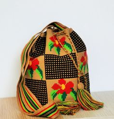 Wayuu mochila bag single thread weave Colombian by MochilaLand.  I like this idea. You could put any picture you like in the squares.