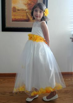 Ivory  flower girls dress with a tulle skirt by juliettaboutique, $118.00  Would work greatfor a fall wedding. Maybe leaves instead of flowers at the bottom of the dress?