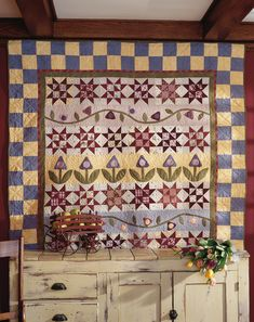 Sisters' Starberries: Designers Claudi and Dana had been looking for an opportunity to design a row quilt that would feature Claudia's applique skills and Dana's favorite fabrics