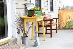 Love the old repurposed picnic basket turned into planter | Vintage spring front porch decor