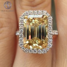 This gorgeous fancy yellow emerald cut diamond engagement ring is encompassed in a halo of micropave set round diamonds. View our website to see more emerald designs. by doreen. Yellow Sapphire Rings, Emerald Cut Diamonds, Round Diamonds, Diamond Cuts, Yellow Diamonds, Pink Sapphire, Emerald Cut Diamond Engagement Ring, Engagement Ring Cuts, Yellow Engagement Rings