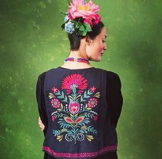 The vest. Black with bold colors. Love the bold flowers too.